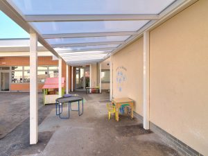 View under Spaceshade School canopy forming outdoor learning area and walkway