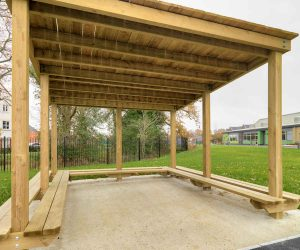 Timber playground shelter close up