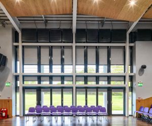 Roller and blackout blinds in school hall